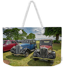 Weekender Tote Bag featuring the photograph Wolseley Motors by Adrian Evans