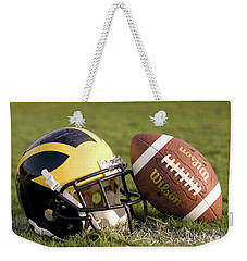 Wolverine Helmet With Football On The Field Weekender Tote Bag