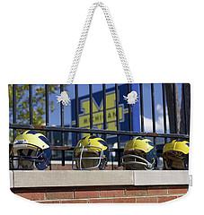 Wolverine Helmets Of Different Eras On Stadium Wall Weekender Tote Bag