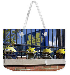 Wolverine Helmets Of Different Eras On Stadium Wall Weekender Tote Bag