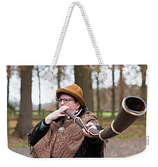 Weekender Tote Bag featuring the photograph Woman Blowing Horn by Hans Engbers