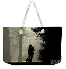 Weekender Tote Bag featuring the photograph Woman Walking Dog by Patricia Hofmeester