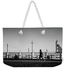 Weekender Tote Bag featuring the photograph Woman Walking In Industry by John Williams