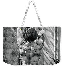 Weekender Tote Bag featuring the photograph Woman With A Gun by Jacob Smith