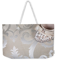 Weekender Tote Bag featuring the photograph Women's Shoe by Andrey  Godyaykin