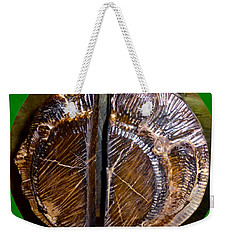 Weekender Tote Bag featuring the photograph Wood Carved Fossil by Francesca Mackenney