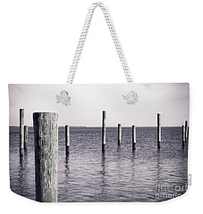 Weekender Tote Bag featuring the photograph Wood Pilings In Monotone by Colleen Kammerer