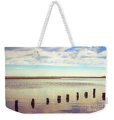 Weekender Tote Bag featuring the photograph Wood Pilings In Still Water by Colleen Kammerer