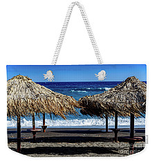 Wood Thatch Umbrellas On Black Sand Beach, Perissa Beach, In Santorini, Greece Weekender Tote Bag