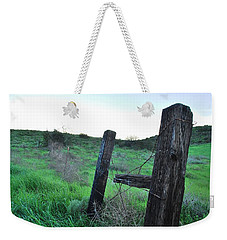 Weekender Tote Bag featuring the photograph Wooden Gate In Field by Matt Harang
