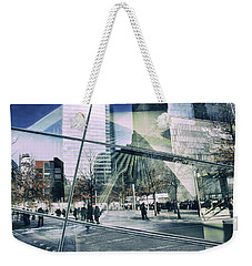 Weekender Tote Bag featuring the photograph World Trade  by Jessica Jenney