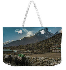 Weekender Tote Bag featuring the photograph Yaks Moving Through Dingboche by Mike Reid