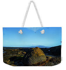 Weekender Tote Bag featuring the photograph Yanakie Rocks by Angela DeFrias