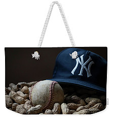 Weekender Tote Bag featuring the photograph Yankee Cap Baseball And Peanuts by Terry DeLuco