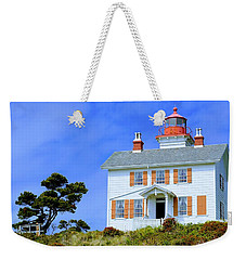 Weekender Tote Bag featuring the photograph Yaquina Bay Lighthouse by AJ Schibig