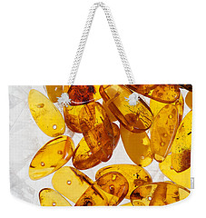 Weekender Tote Bag featuring the photograph Yellow Amber Stones  by Andrey  Godyaykin