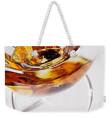 Weekender Tote Bag featuring the photograph Yellow Amber Stones In A Glass. by Andrey  Godyaykin