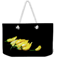 Yellow Chillies On A Black Background Weekender Tote Bag