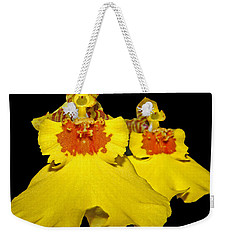 Weekender Tote Bag featuring the photograph Yellow Dresses by Judy Vincent