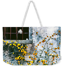 Weekender Tote Bag featuring the photograph Yellow Flowers And Window by Silvia Ganora
