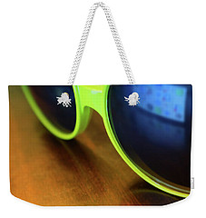Weekender Tote Bag featuring the photograph Yellow Goggles With Reflection by Carlos Caetano