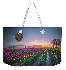 Weekender Tote Bag featuring the photograph Yellow Hot Air Balloon Over Tulip Field In The Morning Tranquili by William Lee