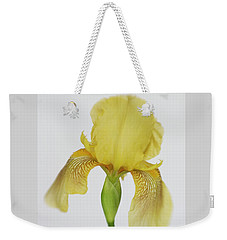 Weekender Tote Bag featuring the photograph Yellow Iris A Symbol Of Passion by David and Carol Kelly