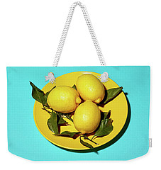 Yellow Lemons On Cyan Weekender Tote Bag by Oleg Cherneikin
