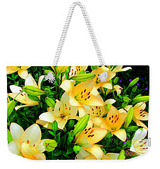 Weekender Tote Bag featuring the photograph Yellow Lilies 2 by Randall Weidner