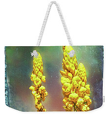 Weekender Tote Bag featuring the photograph Yellow On Blue by Lewis Mann