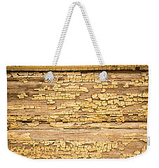 Weekender Tote Bag featuring the photograph Yellow Painted Aged Wood by John Williams