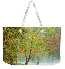 Weekender Tote Bag featuring the photograph Yellow Trees by Iris Greenwell