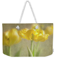 Weekender Tote Bag featuring the photograph Yellow Tulips by Elena Nosyreva