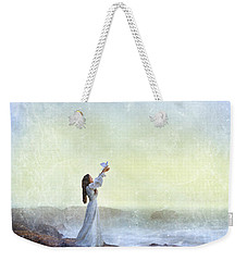 Young Lady Releasing A Dove By The Sea Weekender Tote Bag by Jill Battaglia