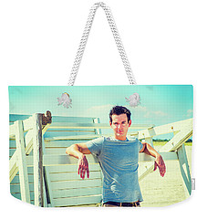 Young Man Relaxing On The Beach Weekender Tote Bag