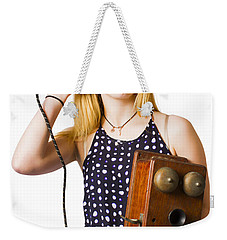 Weekender Tote Bag featuring the photograph Young Telephonist Phoning Using Old Vintage Phone by Jorgo Photography - Wall Art Gallery