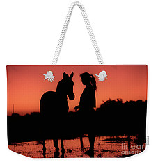 Weekender Tote Bag featuring the photograph Youth by Jim and Emily Bush