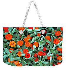 Weekender Tote Bag featuring the photograph Zinnia Flower - Profusion Orange by Janine Riley