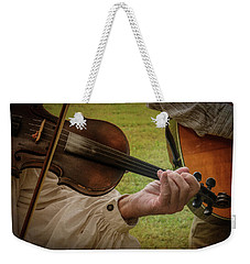 Weekender Tote Bag featuring the photograph Fiddler by Guy Whiteley