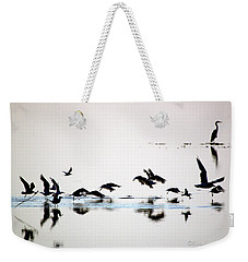 Weekender Tote Bag featuring the photograph Flight by Buddy Scott