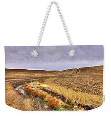 Weekender Tote Bag featuring the photograph Plowed Under by David Patterson