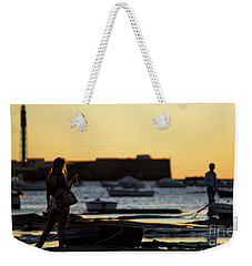 Weekender Tote Bag featuring the photograph Woman At Sunset La Caleta Beach Cadiz Spain by Pablo Avanzini