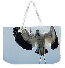 Weekender Tote Bag featuring the photograph Woodstork Nesting by Donald Brown