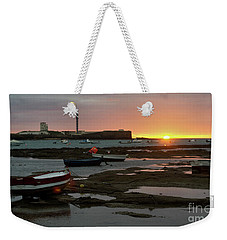 Weekender Tote Bag featuring the photograph Beached Boats At Sunset Cadiz Spain by Pablo Avanzini