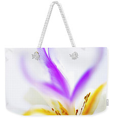 Weekender Tote Bag featuring the photograph White Iris II by John Rodrigues