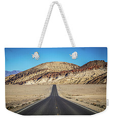 Weekender Tote Bag featuring the photograph Lonely Road In Death Valley National Park In California by Alex Grichenko