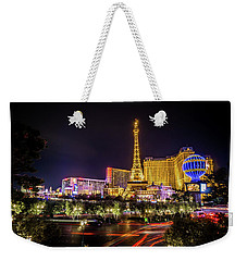 Weekender Tote Bag featuring the photograph Nigh Life And City Skyline In Las Vegas Nevada by Alex Grichenko