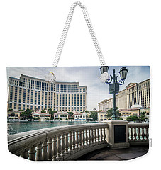 Weekender Tote Bag featuring the photograph Bellagio Hotel And Other Architecture In Las Vegas Nevada by Alex Grichenko