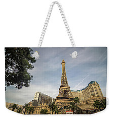 Weekender Tote Bag featuring the photograph View On The Replica Of Eiffel Tower At Paris Hotel   by Alex Grichenko