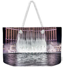 Weekender Tote Bag featuring the photograph World Famous Fountain Water Show In Las Vegas Nevada by Alex Grichenko